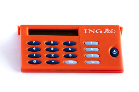headquartered: BUCHAREST, ROMANIA - FEB 17,2014: ING Home Bank token isolated on white. The ING Group is a Dutch multinational banking and financial services corporation headquartered in Amsterdam.