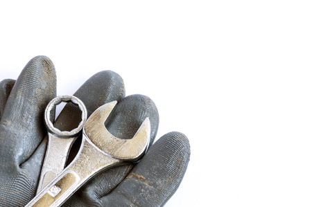 Set of tools and glove over a white background with space for text photo