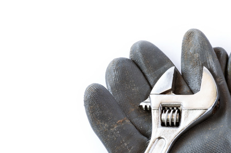 Tools and glove  over a white background with space for text photo