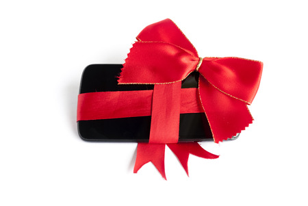 Smart Phone with Red Ribbon and Bow isolated on white  photo