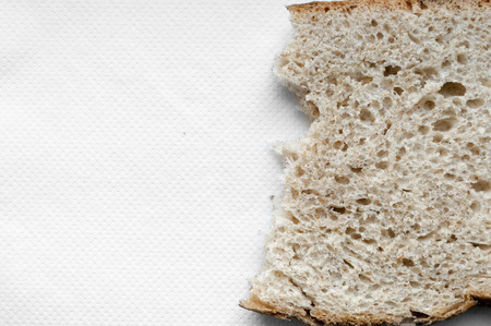 ripped bread on white background photo