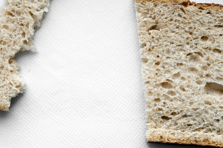 Cutted and ripped bread on white background photo