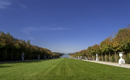 louis the rich heritage: VERSAILLES - October 19: Garden of Versailles Palace, Versailles, France on October 19, 2014. Palace Versailles was a royal chateau. It was added to UNESCO list of World Heritage Sites. Editorial