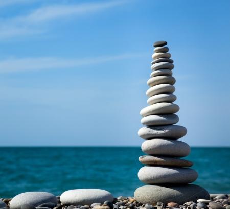 meditation stones: Pyramid of stones for meditation lying on seacoast