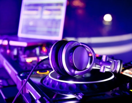 Dj mixer with headphones at a nightclub photo