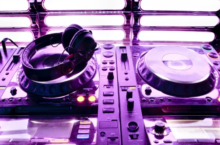 Dj mixer with headphones at a nightclub Stock Photo - 19294235