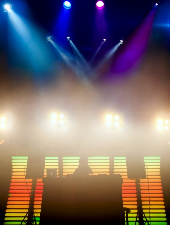 dj turntable: DJ at a nightclub on the scene for a game. Bright beautiful lighting Stock Photo