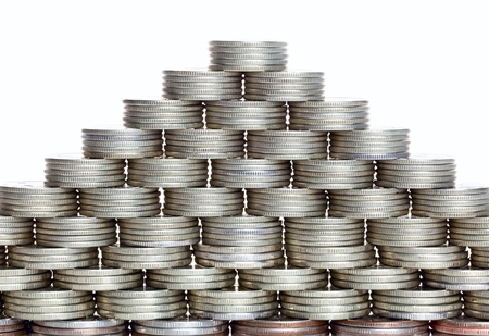 Pyramid of the coins isolated on white background Stock Photo