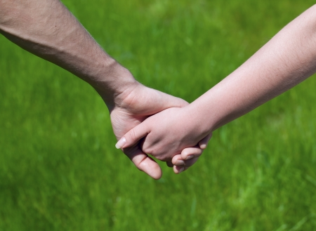 community recognition: Lovely Young couple hold each others hand