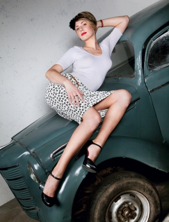 charms: Attractive sexy woman portrait on background with old car
