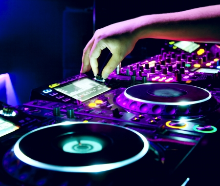 audio mixer: Dj mixes the track in the nightclub at a party