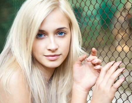 combed: Portrait of attractive beautiful blonde girl with blue eyes   Stock Photo