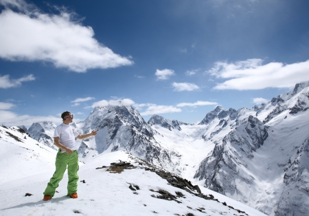 dombay: Lone man in a beautiful mountain landscape of the Caucasus Mountains Dombai
