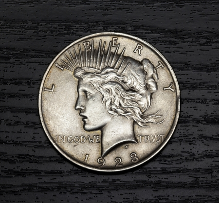 dime: Old antique coin. One U.S. dollar in 1923