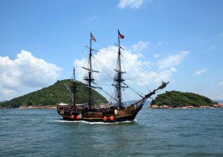 Historic old ship in the ocean near the islands