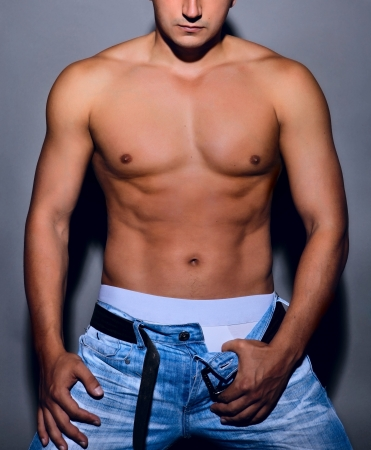 men s: Tanned muscular male torso in the jeans