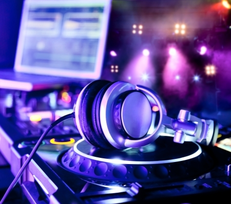 turntables: Dj mixer with headphones at a nightclub Stock Photo