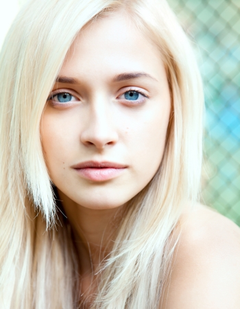 combed: Portrait of attractive beautiful blonde girl with blue eyes