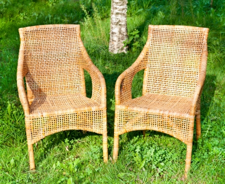 comfortable chair: Two wicker comfortable chair on the grass