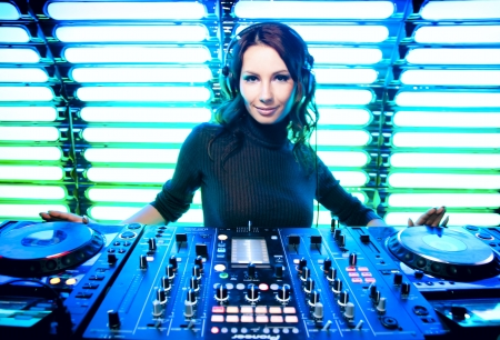 Attractive beautiful girl DJ in the nightclub photo