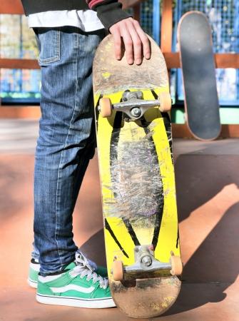 Skateboarder legs before jumping on the railing