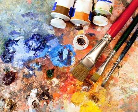 art gallery: Artistic equipment: paint, brushes, spatula and art palette Stock Photo