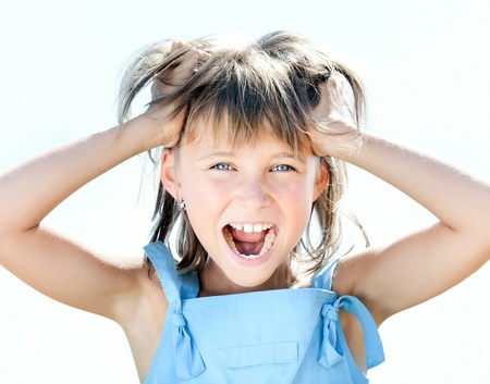Portrait of beautiful young girl screams and with shocked expression photo