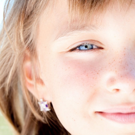 combed: Portrait of attractive beautiful young girl with freckles and blue eyes