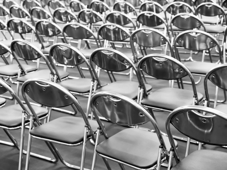 Rows of metal chairs at the conference in an empty room. Back view Stock Photo - 19523650