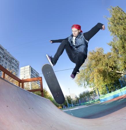 halfpipe: Skateboarder jumping in the halfpipe Stock Photo
