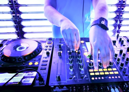 Dj playing the track in the nightclub at a party photo
