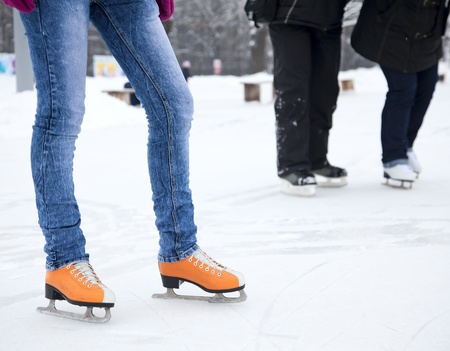ICE RINK: Feet skater standing on the ice