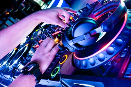Dj playing track in nightclub at party photo