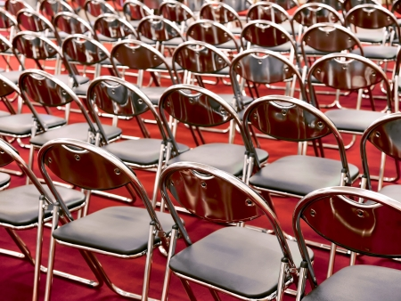 Rows of metal chairs at the conference in an empty room  Back view Stock Photo - 19523651