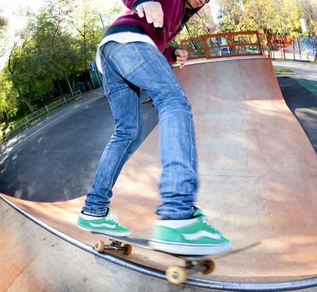 Skateboarder legs before jumping in the halfpipe  Shooting fisheye lens optics
