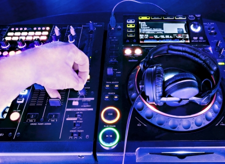dj mixer: Dj playing the track in the nightclub at a party. DJ headphones