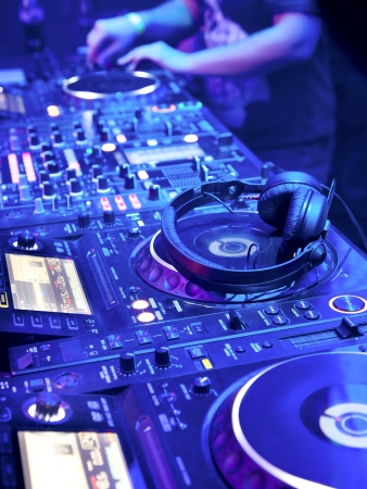 club scene: Dj playing the track in the nightclub at a party  DJ headphones Stock Photo