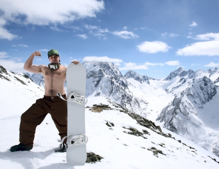dombay: Portrait of snowboarder in a beautiful mountain landscape of the Caucasus Mountains Dombai