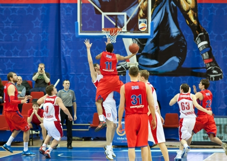 opponents: MOSCOW, RUSSIA - DECEMBER 17:  Sammy Mejia of CSKA basketball team throws the ball into opponents basket SPARTAK Primorye on December 17, 2011 in Moscow, Russia