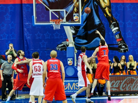 opponents: MOSCOW, RUSSIA - DECEMBER 17:  Dariusz Lavrynovych of CSKA basketball team throws the ball into opponents basket SPARTAK Primorye on December 17, 2011 in Moscow, Russia