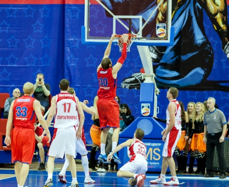 opponents: MOSCOW, RUSSIA - DECEMBER 17: Dmitry Sokolov of CSKA basketball team throws the ball into opponents basket SPARTAK Primorye on December 17, 2011 in Moscow, Russia  Editorial