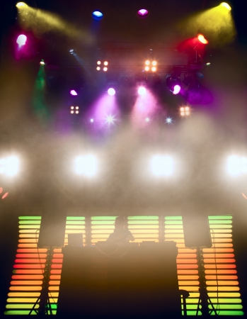 stage lighting: DJ at a nightclub on the scene for a game  Bright beautiful lighting