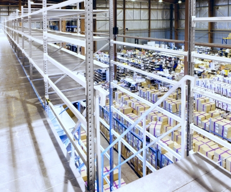 Interior of the new and modern warehouse space in a well lit large room Stock Photo - 19852414