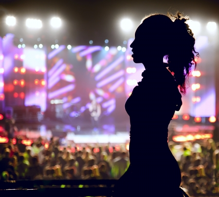 Dancing silhouette of woman in a nightclub photo