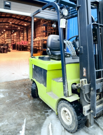 Forklift standing at the entrance of a large modern warehouse Stock Photo - 19852420