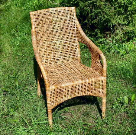 cane chair: Wicker comfortable chair on the grass