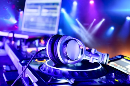 turntables: Dj mixer with headphones at nightclub