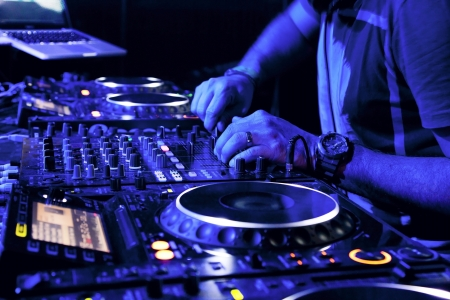mixer: Dj mixes the track in the nightclub at party