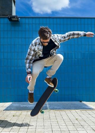 Skateboarder jumping on skateboard Stock Photo