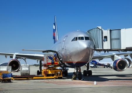 Aircraft maintenance people during refueling and loading baggage in aircraft Stock Photo